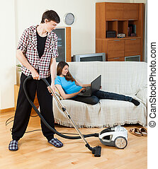 Clean up man, while wife lying with notebook - Clean up man,...