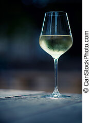 color image of chilled white wine in a glass , with copy...