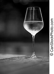 Image of chilled white wine in a glass , with copy space