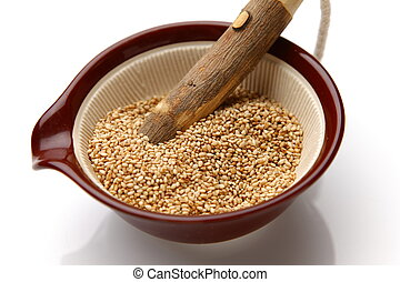 white sesame seed - close up shot of white sesame seed in...