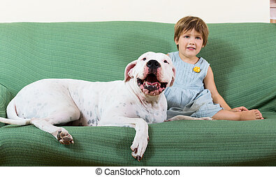small nice girl on couch with dog