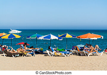 Blanes beach - BLANES, SPAIN - 28 JULY: Tourists enjoy at...