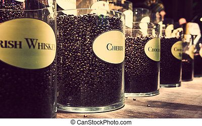 Glass jars with different flavour coffee on display