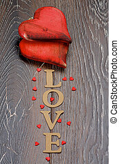 Valentine - Two Wooden Red Hearts and Cardboard Word Love...