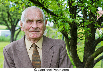Handsome 80 plus year old senior man posing for a portrait...