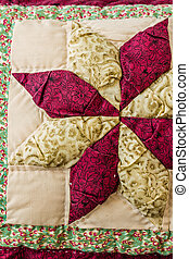 Pillow with Patchwork Design - Close up of a pillow with...