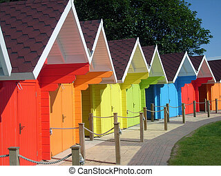 Bright colored seaside chalets - Row of brightly colored...