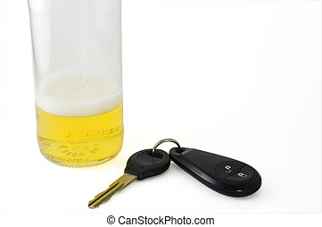 Beer and keys - Nearly empty beer bottle and car keys.