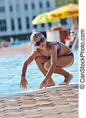 swimming pool fun - happy kids have fun on outdoor swimming...