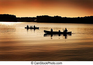 Silhouette of Canoers on Lake - Image of silhouette of...