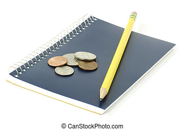 Notepad, pencil and change Education savings concept