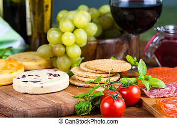 soft cheese with fruits and crackers