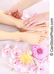 reflexology - Woman receiving a foot massage at the health...