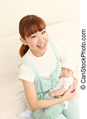 time to sleep - portrait of young Japanese mom and her baby...
