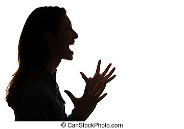 profile of screaming woman in silho - side view of a yelling...