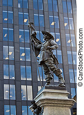 Statue of Paul de Chomedey with modern building background in Mo