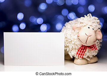 Sheep with blank card - White sheep toy the Chinese symbol...