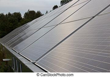 Solar energy panels in a farmer's field