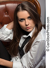 Closeup portrait of young sexy provocative woman wearing men