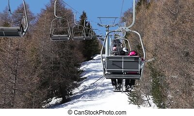 People moves on hoist - Ski lifts with skiers above...