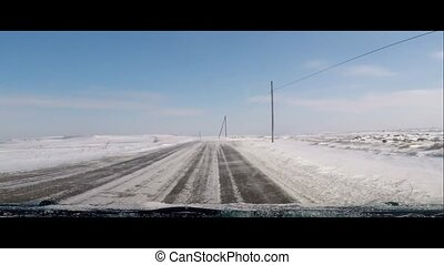 Driving in winter, snowy road