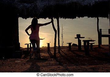 Lady Watching A Sunset