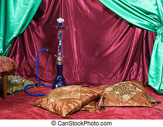 Hookah room - Room with a hookah and pile of pillows