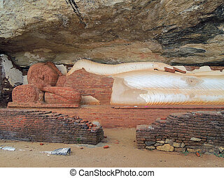 sleeping buddha statue - a sleeping buddha statue in Sri...