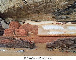 sleeping buddha statue - a sleeping buddha statue in Sri...