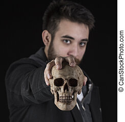 Young Man in Black Jacket Holding Skull