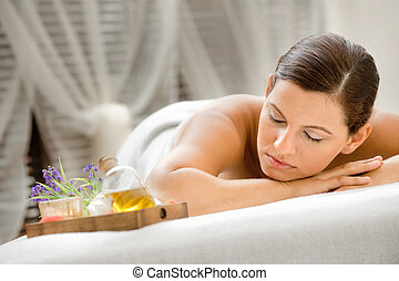 Woman in Spa - An attractive caucasian woman lying down in a...