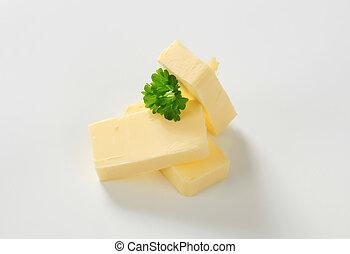 Fresh butter  - Pieces of fresh butter  - studio shot