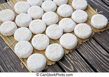 Small goat cheese heads - Set of small heads of young goat...