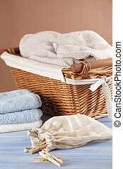 Washing still life - Clothespins in the bag, towels, and a...