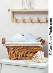Interior of laundry room - Basket with towels and...