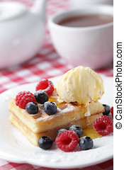 Waffles with berries and ice cream