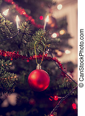 Retro image of Christmas tree decorated with traditional...