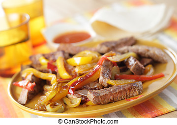Beef fajitas - Beef steak fajitas on the plate