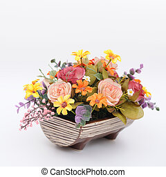 Many colorful flowers in wooden pot, artificially
