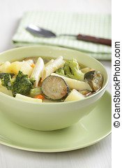 Minestrone, vegetable soup with pasta in the bowl
