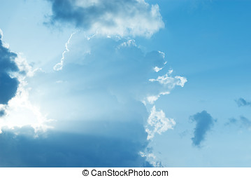 Blue sky with sun shine through the clouds