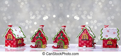 Christmas house decorated with multicolored glaze or...