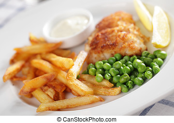 Fish and chips - French fries, roasted fish, green peas,...