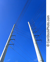 High Voltage Power Lines run through a large metal Utility pole
