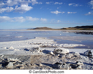 Rocky salty shore and water of the great Salt Lake with...
