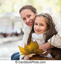 happy woman with little daughter