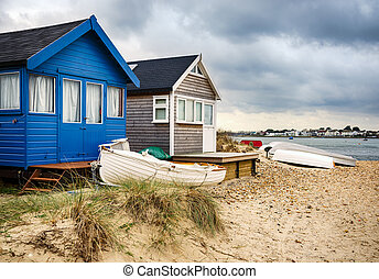 Beach Huts and Boats - Beach huts and boats in sand dunes at...