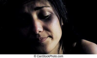 woman in the dark touching bruises - Young woman in the dark...
