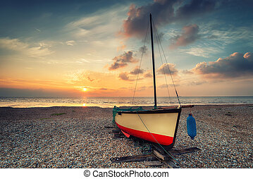 Vintage effect sailing boat at sunset
