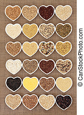 Grains - Grain and cereal food selection in heart shaped...